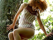 It looks like Avina is one of those forest nymphs who adore relaxing in the phat shade of the trees. This redhaired witch also adores petting her body and this babe at no time minds to masturbate her tight lil pussy. Look at her outstanding smiling face - this babe will tease you with this magic self-masturbation, and I swear your 10-Pounder will like this action, even if there is no fucking here.