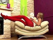 Joanna is cute and made cute by her choice of red hose for the wicked video. She's in the mood for anal sex today and her stockings turn him on to the point of pure stiffness in his pants. He's hard as a rock and ready to copulate that chocolate hole and so that babe receives from behind and while on top. The hose are rolled down as they fuck.